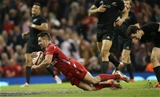 22.11.14 -  Wales v New Zealand, Dove Men Series 2014, Cardiff -  Rhys Webb of Wales dives in to score try  © Huw Evans Agency, Cardiff