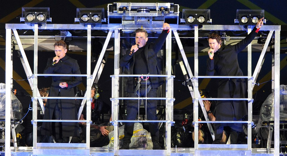 14.06.11 - Mark Owen, Robbie Williams and Howard Donald perform as Take That play the Millennium Stadium.© Huw Evans Picture Agency
