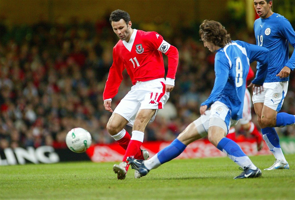01.03.06..Wales v Paraguay, Friendly International, Millennium Stadium, CardiffWales' Ryan Giggs is challenged by Edgar Barreto©Huw Evans, Cardiff