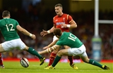 08.08.15 - Wales v Ireland - Dove Men Series 2015 -Scott Williams of Wales kicks past Darren Cave and Paddy Jackson of Ireland.