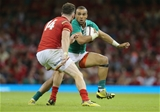 08.08.15 - Wales v Ireland, Dove Men Tests 2015 - Simon Zebo of Ireland takes on Alex Cuthbert of Wales