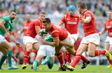 29.08.15 - Ireland v Wales - Guinness Summer Series -Rhys Webb of Wales is tackled by Dave Kearney of Ireland.