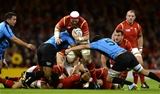20.09.15 - Wales v Uruguay - Rugby World Cup 2015 -Jake Ball of Wales is tackled by Mario Sagario and Jorge Zerbino of Uruguay.
