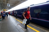 21.09.15 - Wales Rugby World Cup Squad Travel to London -Dan Lydiate walks to the team train to London at Cardiff Central Station.