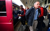 21.09.15 - Wales Rugby World Cup Squad Travel to London -Scott Baldwin walks to the team train to London at Cardiff Central Station.