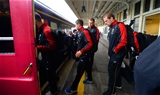 21.09.15 - Wales Rugby World Cup Squad Travel to London -Lloyd Williams, James King and Alun Wyn Jones walks to the team train to London at Cardiff Central Station.