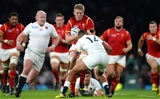 26.09.15 - England v Wales - Rugby World Cup 2015 -Bradley Davies of Wales is tackled by Anthony Watson of England.