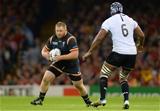 01.10.15 - Wales v Fiji - Rugby World Cup 2015 -Samson Lee of Wales is tackle by Dominiko Waqaniburotu of Fiji.