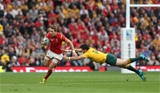 10.10.15 - Australia v Wales, Rugby World Cup 2015 - Liam Williams of Wales gets away from the tackle of Adam Ashley-Cooper of Australia