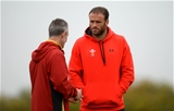 13.10.15 - Wales Rugby Training -Rob Howley talks to Jamie Roberts during training.