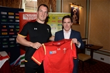 16.10.15 - Actor and Comedian Rob Brydon presents a match jersey to Gethin Jenkins and the Wales rugby squad ahead of their Rugby World Cup quarter final tomorrow against South Africa.