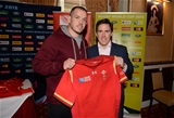 16.10.15 - Actor and Comedian Rob Brydon presents a match jersey to Paul James and the Wales rugby squad ahead of their Rugby World Cup quarter final tomorrow against South Africa.