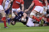 13.02.16 - Wales v Scotland - RBS 6 Nations -Dave Denton of Scotland is tackled by Samson Lee of Wales