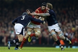 13.02.16 - Wales v Scotland - RBS 6 Nations 2016 - Luke Charteris of Wales is tackled by Willem Nel and Jonny Gray of Scotland.