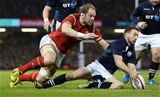 13.02.16 - Wales v Scotland - RBS 6 Nations 2016 - Greig Laidlaw of Scotland is hounded by Alun Wyn Jones of Wales for the ball.