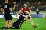 18.06.16 - New Zealand v Wales - Steinlager Series, Second Test -Jonathan Davies of Wales is tackled by Ryan Crotty of New Zealand.