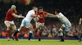 11.02.17 - Wales v England - RBS 6 Nations Championship - Rhys Webb of Wales is tackled by Joe Marler and Courtney Lawes of England.